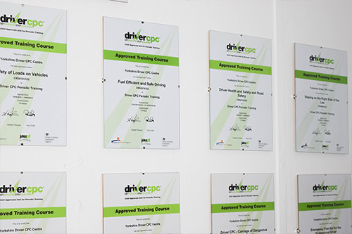 Certificates hanging on a wall